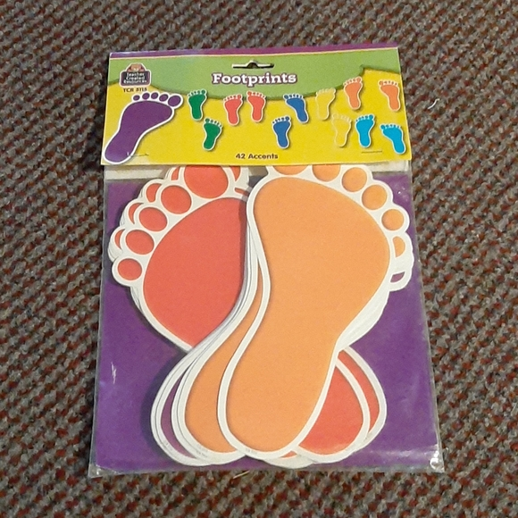 42 multi-coloured paper footprints